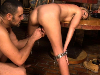 Restrained euro sub gagging on doms cock