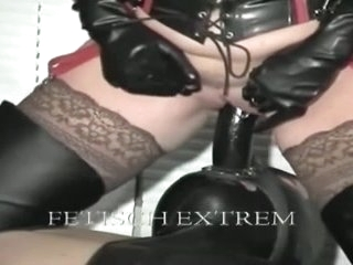 Latex mistresses fuck one slave after the other